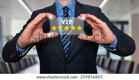 Businessman holding five star rating VIP - Office - Stock Image - stock photo