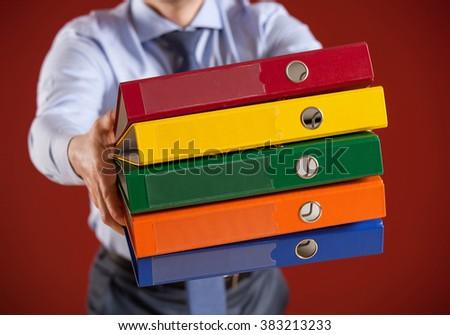 Businessman holding folders, closeup shot - stock photo