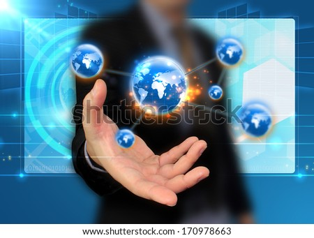 businessman holding globe, connected  - stock photo