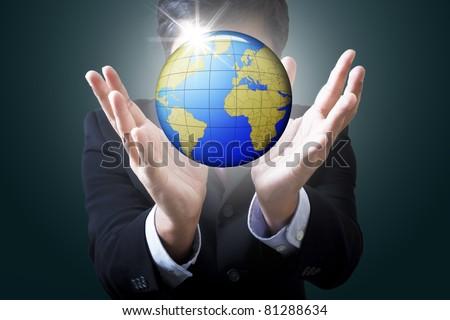 Businessman holding globe in hand :Data source: NASA - stock photo