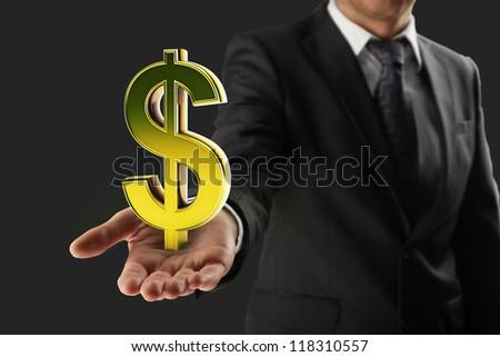 Businessman holding  gold dollar sign - stock photo