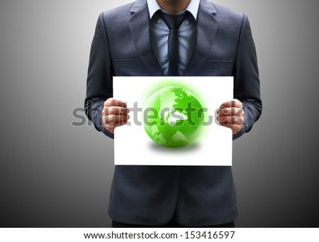 businessman holding green globe  - stock photo