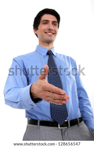 Businessman holding hand out - stock photo