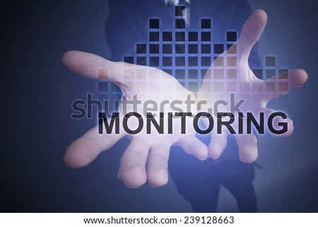 "Businessman holding in his hands glowing inscription ""Monitoring"". business concept. increase profits. increase sales. - stock photo"