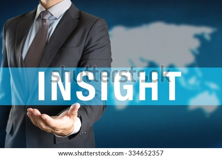 Businessman holding INSIGHT word with world background - stock photo