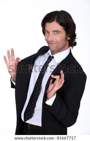 Businessman holding jacket open - stock photo