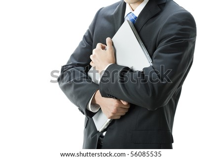 Businessman holding laptop - stock photo