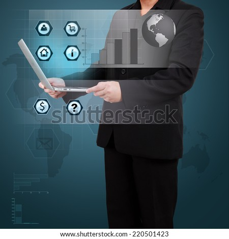 Businessman holding laptop  with globe and icon application on virtual screen. Concept of online business. - stock photo
