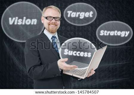 Businessman Holding Laptop with Keywords to Success Around Him - stock photo