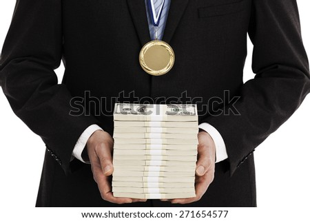 Businessman holding large stack of money and wearing a gold medal - stock photo