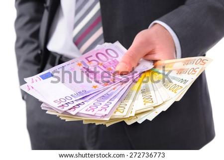 Businessman holding many euros banknotes - stock photo