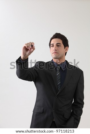 businessman holding marker pen doing presentation - stock photo