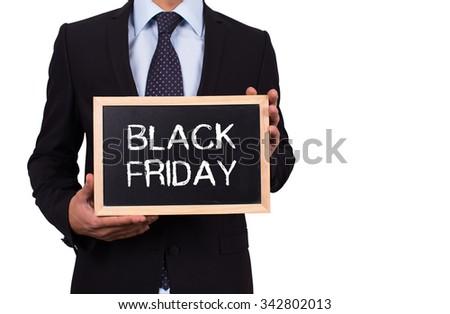 Businessman holding mini blackboard with BLACK FRIDAY message - stock photo