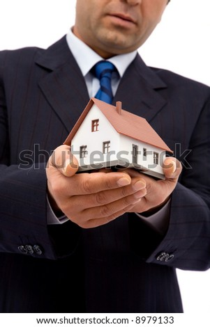 businessman holding mini house for real estate concept - stock photo