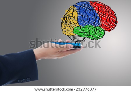 Businessman Holding mobile phone with brain, For education and technology concept. - stock photo
