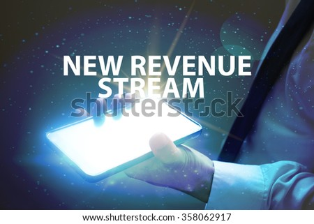 businessman holding mobile phone with NEW REVENUE STREAM text on virtual screen. Internet concept. Business concept. Business idea - stock photo