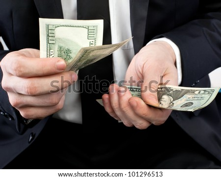 Businessman holding money in his hands - stock photo