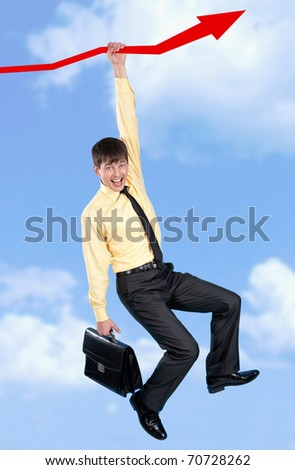Businessman holding on to a red arrow and screaming - stock photo