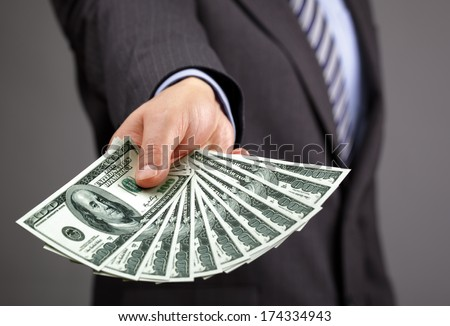 Businessman holding one hundred dollar bills concept for paying, business wealth and banking - stock photo