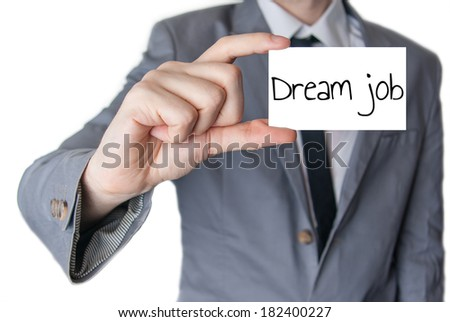 Businessman holding or showing business card with text Dream job - stock photo