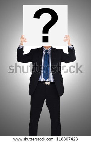 Businessman holding paper show question mark - stock photo