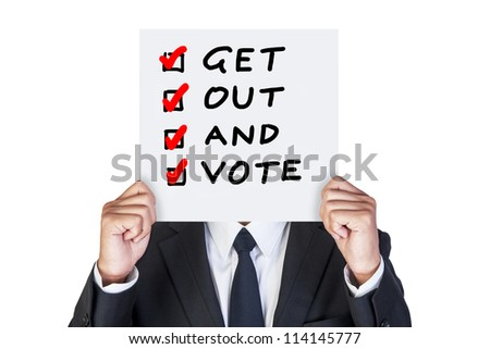 Businessman holding paper that say campaign voting - stock photo