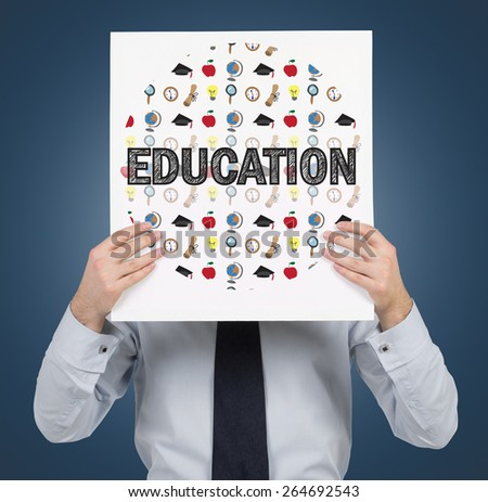 businessman holding paper with education icons - stock photo