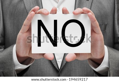 Businessman holding paper with the word no - stock photo