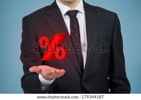 Businessman holding percentage mark - stock photo