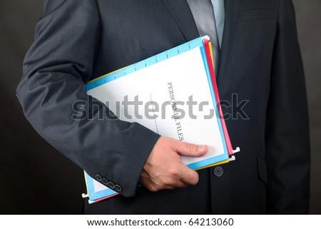 Businessman holding Personnel Files folder - stock photo