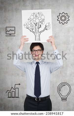 businessman holding placard with money tree on gray background - stock photo