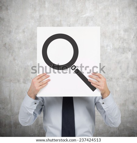 businessman holding poster with magnifier, searching concept - stock photo