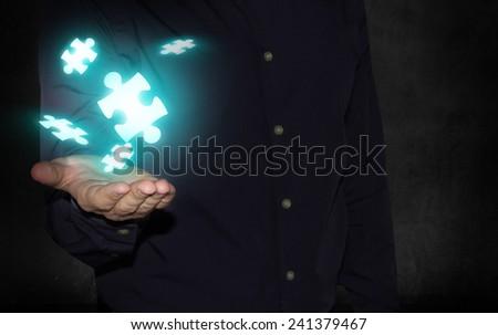 businessman holding puzzle pieces - stock photo