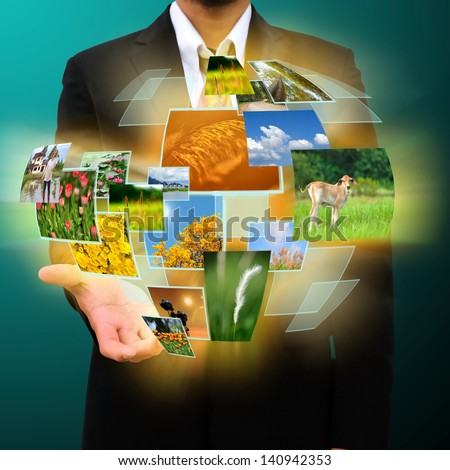 businessman holding Reaching images streaming in hands .Environmental concept - stock photo