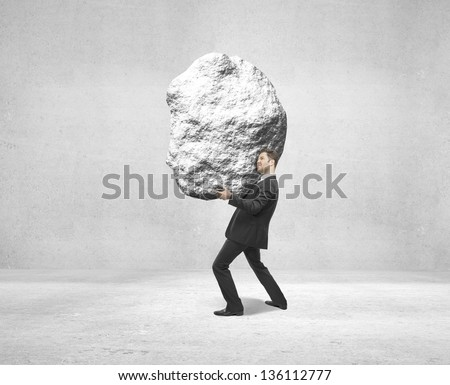 businessman holding rock on white background - stock photo