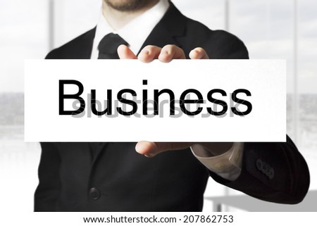 businessman holding sign business - stock photo