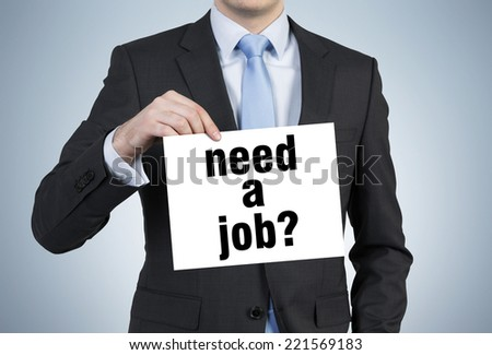 "Businessman holding sign ""need a job""  - stock photo"