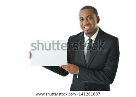 Businessman holding small blank board to be filled in with ideas and concepts - stock photo
