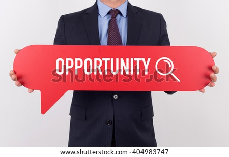 Businessman holding speech bubble with a word OPPORTUNITY - stock photo
