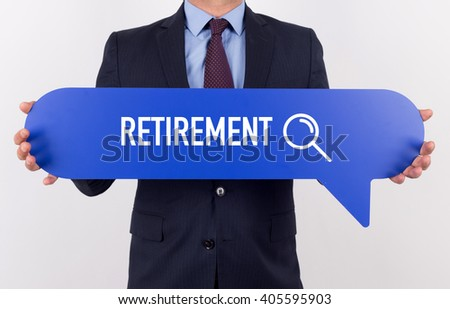 Businessman holding speech bubble with a word RETIREMENT - stock photo