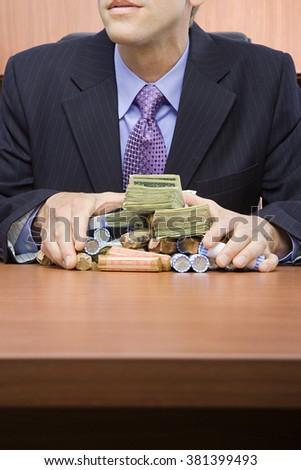 Businessman holding stack of money - stock photo