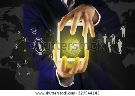 Businessman holding tablet-pc with social network structure - stock photo