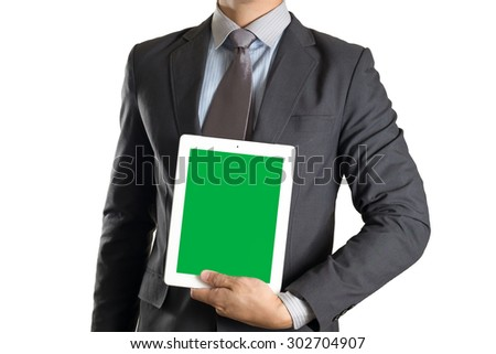 Businessman holding tablet with green screen on white isolated background - stock photo