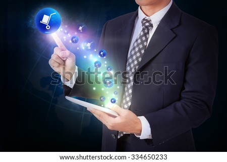 Businessman holding tablet with pressing delivery icon button. internet and networking concept - stock photo
