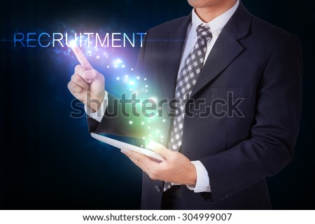 Businessman holding tablet with pressing recruitment sign. internet and networking concept - stock photo