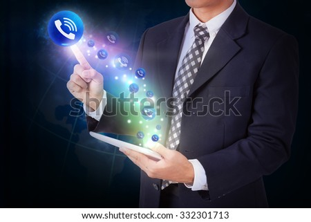 Businessman holding tablet with pressing telephone sign icon button. internet and networking concept - stock photo