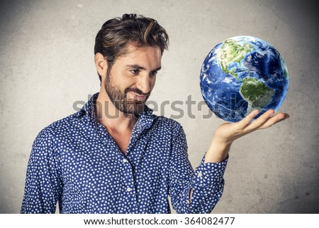 Businessman holding the earth in his hand - stock photo