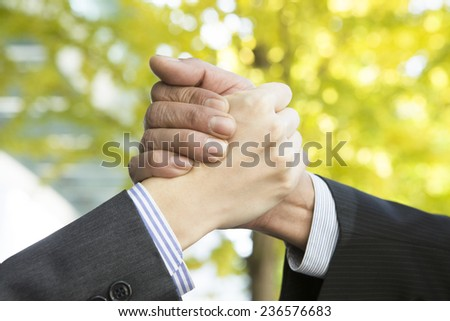 Businessman holding the hand of each other - stock photo