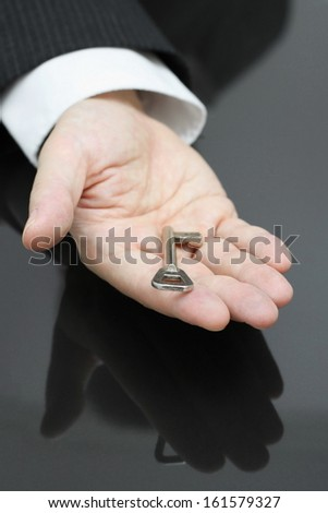businessman holding the key to success - stock photo