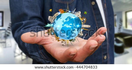 Businessman holding the planet earth surrounded by famous monuments of the world in his hands '3D rendering' - stock photo